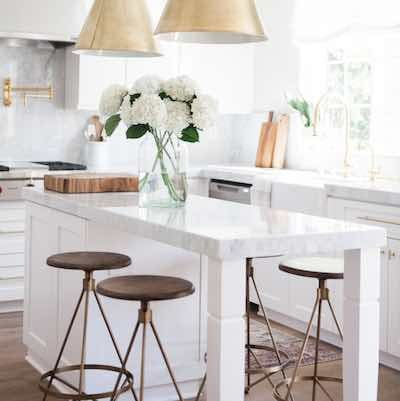 white kitchen from blog on how to avoid the 5 most common kitchen mistakes by Maria Killam, shared by Paper Moon Painting, San Antonio