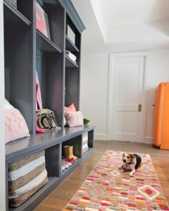 Painted cabinets in Benjamin Moore BM CSP-120 Burnt Ember by Paper Moon Painting company, Austin cabinet painters with dog