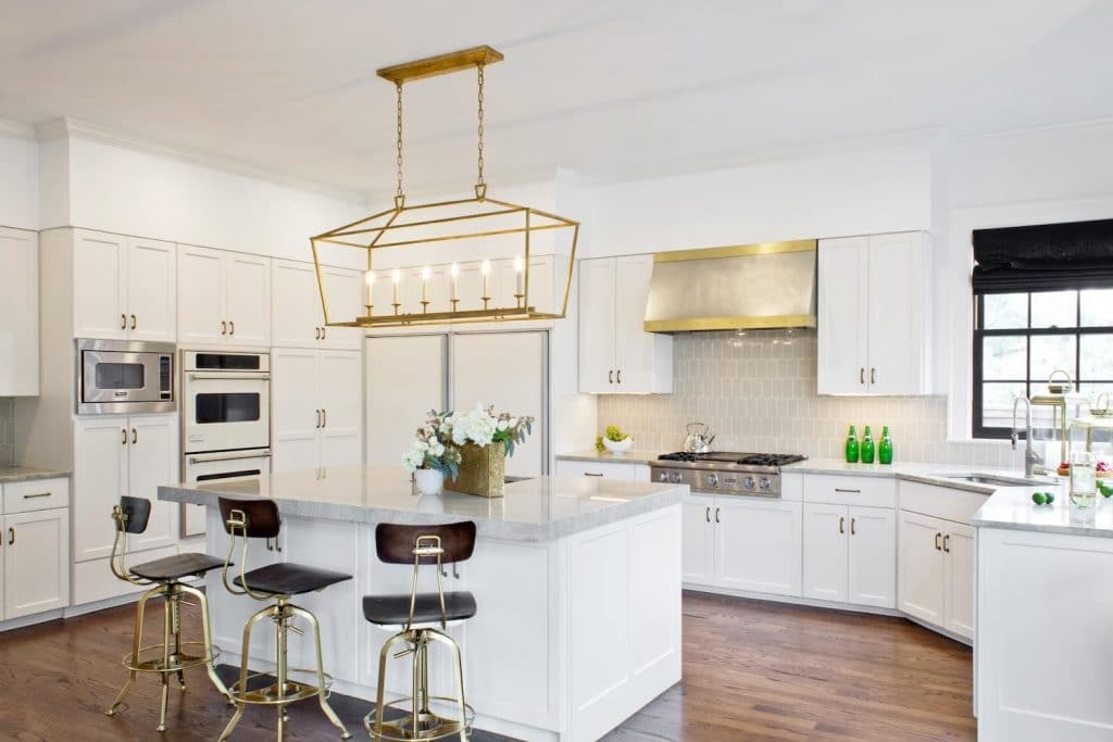 White kitchen cabinets in Benjamin Moore's Decorator's White, Paper Moon Painting company, Austin