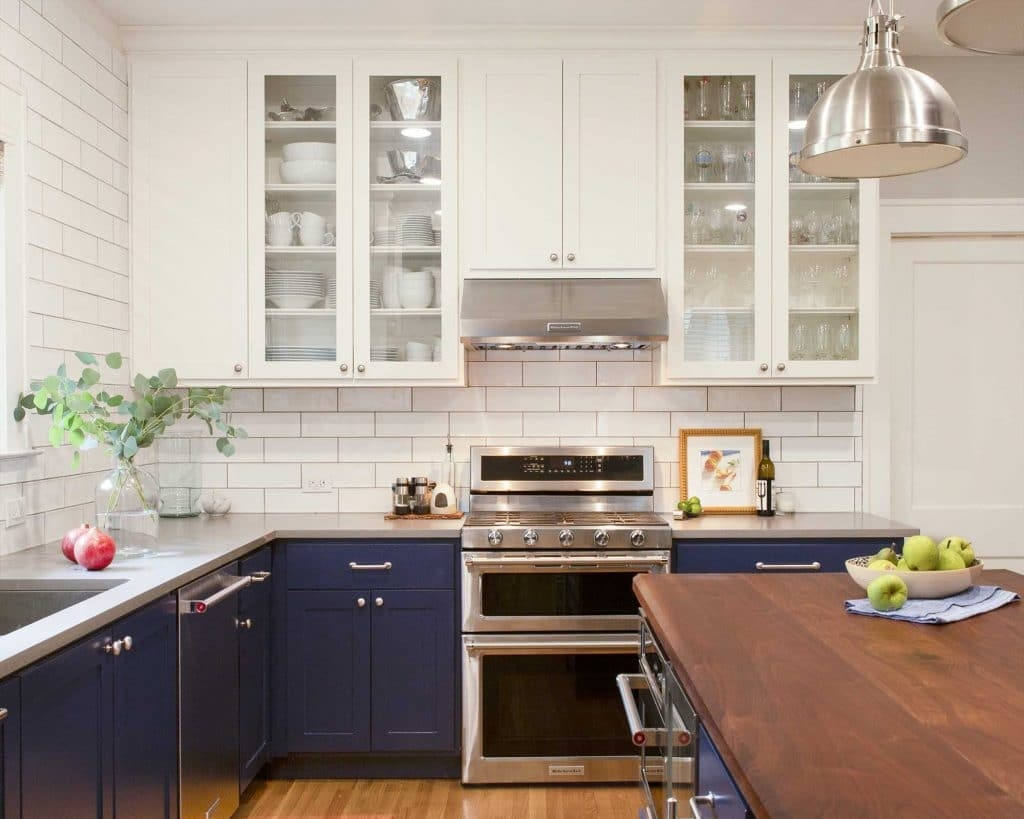 Kitchen two-tone cabinets in Sherwin Williams SW 7005 Pure White and 9179 Anchors Aweigh