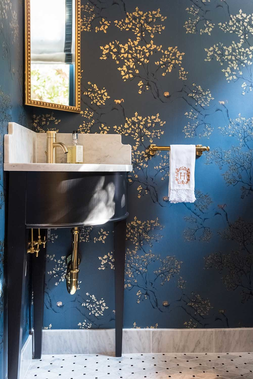 Dark blue wallpaper in guest powder bath, installation by Paper Moon Painting, Alamo Heights