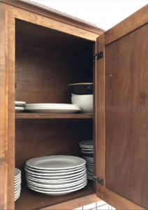 Older kitchen cabinets, with dark stained insides