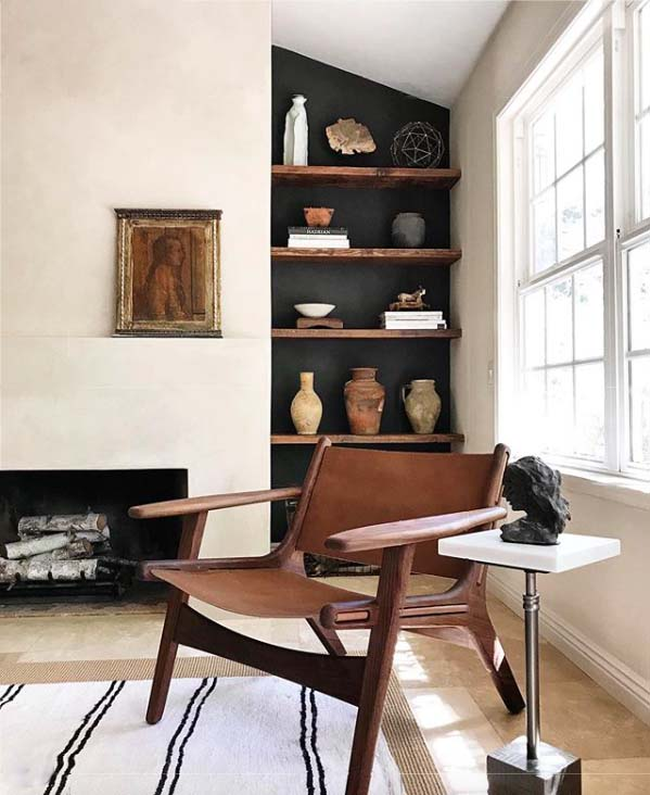 Black accent wall and bookshelves, fireplace, design by Carol Estes