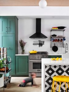 """East Austin kitchen with Ikea cabinets painted in Benjamin Moore's 469 """"Backwoods"""", Paper Moon Painting"""