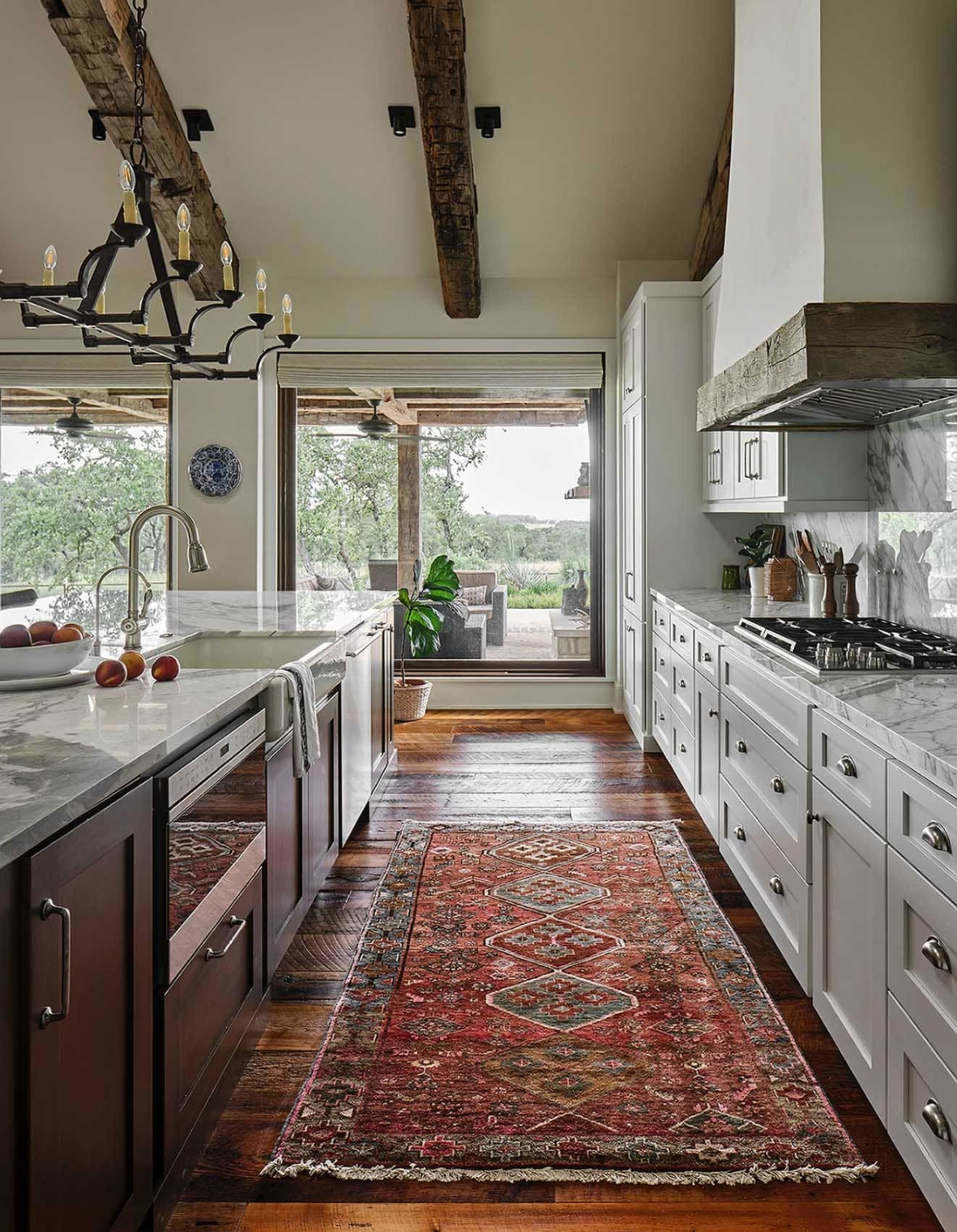 Hill Country Texas ranch home with walls painted in Benjamin Moore Wind's Breath, Paper Moon Painting, San Antonio, kitchen aisle