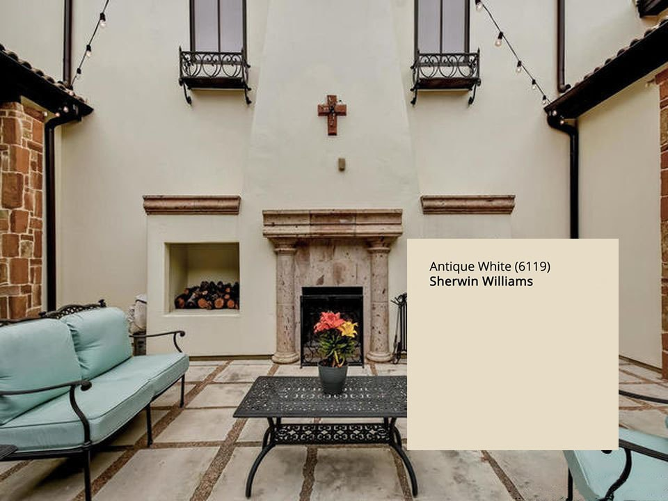 House exterior stucco paint in Sherwin Williams 6119 Antique White, yellow-beige, undertones in exterior paint colors blog