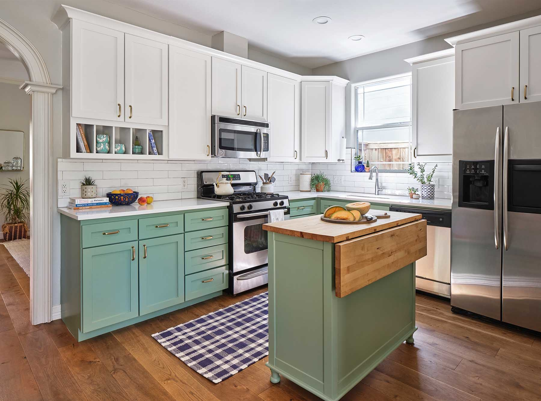 Green and white two-tone kitchen cabinets painted in BM Greenwich Village and SW Alabaster, Paper Moon Painting contractor, Austin Hyde Park